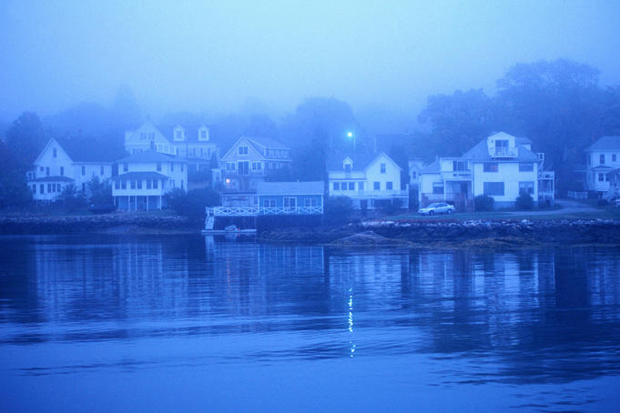 Boothbay Harbor, houses in morning fog.