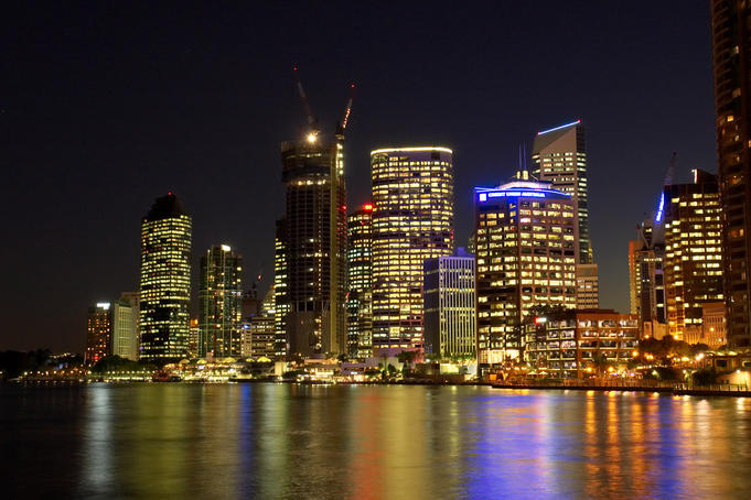 City skyline and Brisbane River at night.