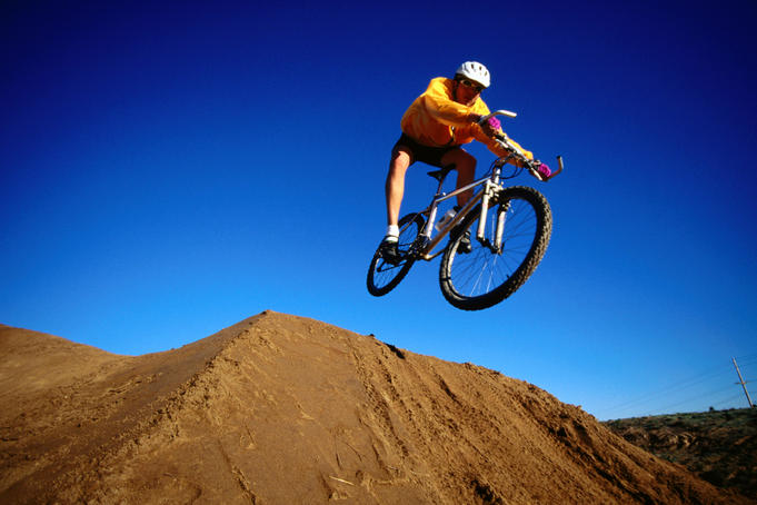 Mountain biker jumping at Solana Beach.