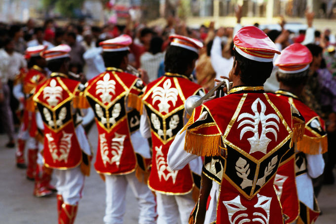 Musicians in costume for wedding procession.