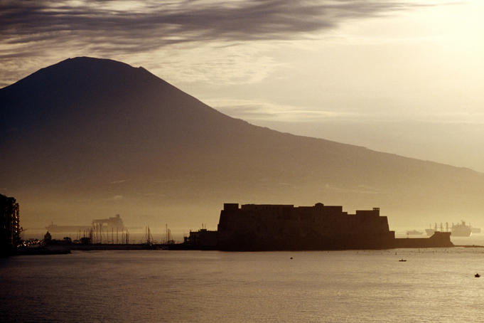 Castel dell'Ovo and Vesuvius in background.