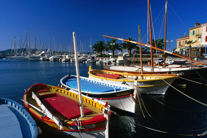 Colourful fishing boats in harbour, Var region.