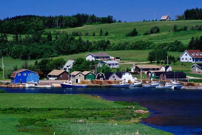 Lobster boats and traditional houses at French River, near Cavendish.