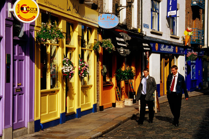 Two men walk past shops in Temple Bar area.