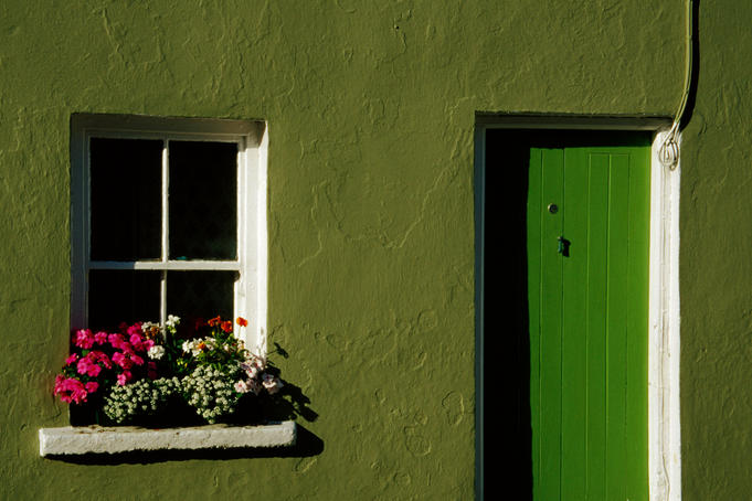 Green cottage door and window detail.