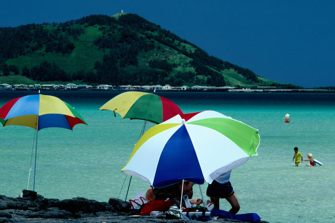 Beach umbrellas, sea and hill in background, Hyopchae Beach.
