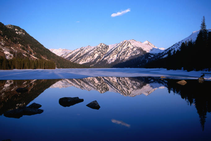 Mountains reflected in Rachmanov's Springs Lake in the Altay Mountains.