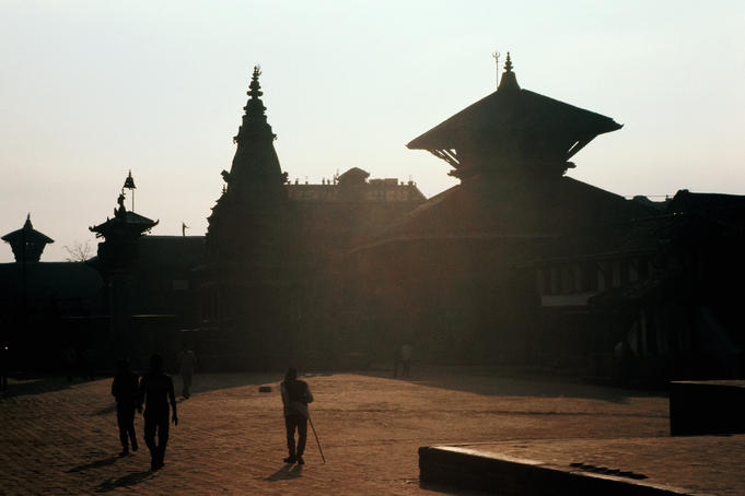 Temples in Durbar Square silhouetted at sunset.