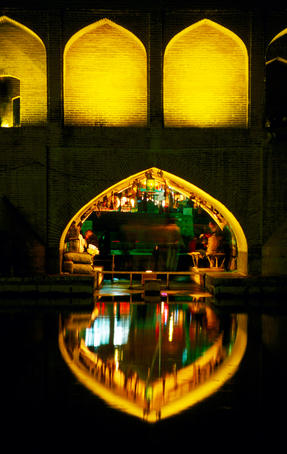 Teahouse under arch of Si-o-Seh Bridge reflected in Zayandeh River.