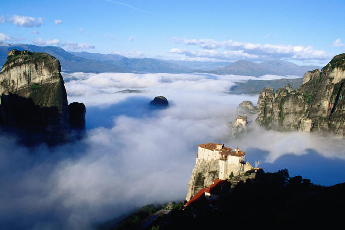 Varvara Rousanour in foreground, and Nikolaou Anapafsa Monasteries in morning fog.