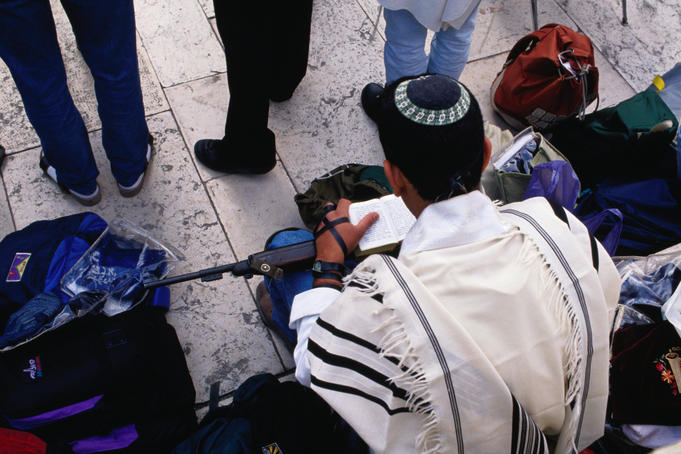 Jewish soldier praying at Wailing Wall.