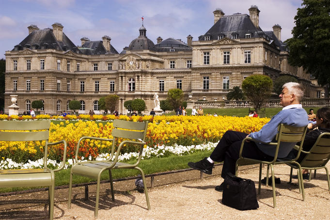 People relaxing in chairs in Jardin du Luxembourg.