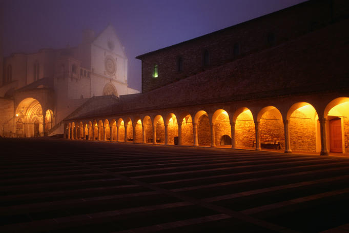 Basilica di San Francesco in fog at night.