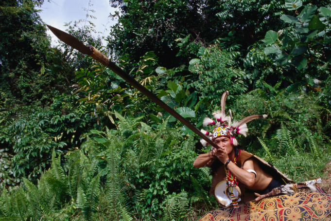 An Orang Ulu Warrior re-enacting battle at the Sarawak Cultural Village.