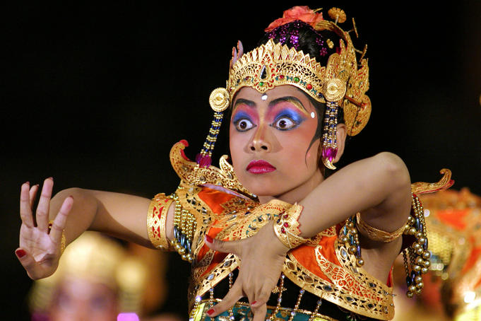 Balinese woman dancing during the great youth gong kebyar compilation from Bangli and Gianyar regency, at Bali Arts Festival, Taman Wedhi Budaya Art Centre.