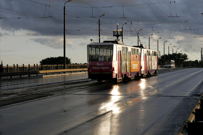 Tram running across Akmens Bridge after thunder storm.