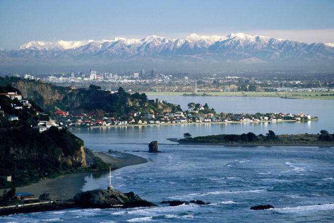 City with southern Alps in background seen from Sumner, Estuary.