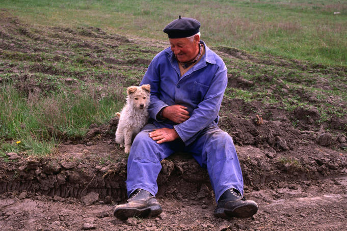 Hungarian farmer with puppy.