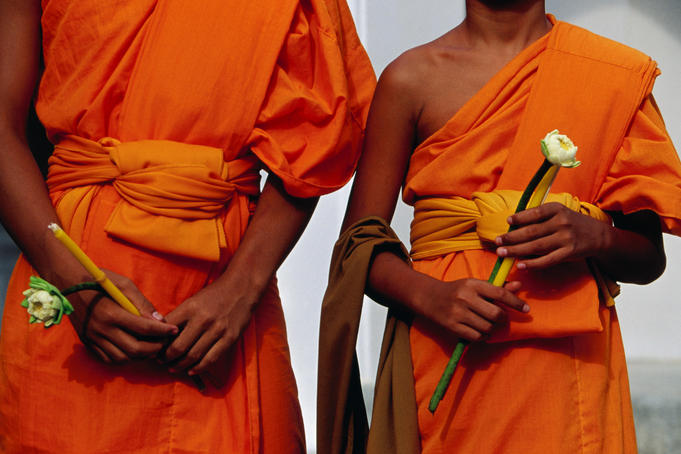 Orange-robed monks at Phra Pathom Chedi, the world's talles Buddhist monument.