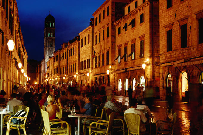 Outdoor cafe on Placa at dusk.