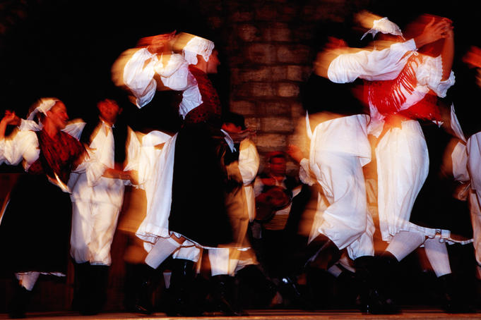 Folk dancers performing traditional dance.
