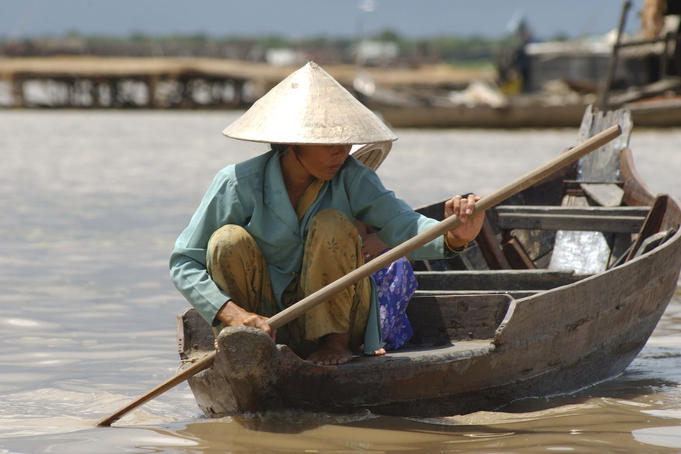 Resident navigates the floating village of Chong Kneas, northern end of Tonle Sap lake.