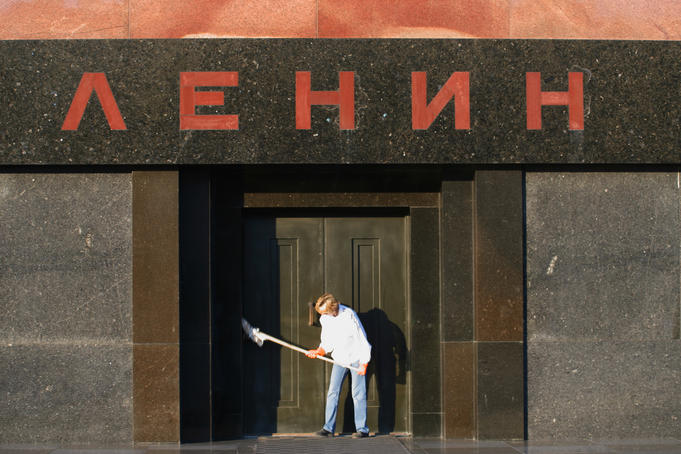 Person dusting down Lenin's Tomb, early morning.