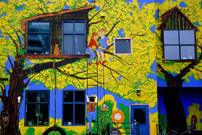 Brightly painted exterior of school on Commercial Drive.