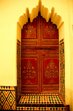 Painted door in central courtyard of Musee de Marrakesh.