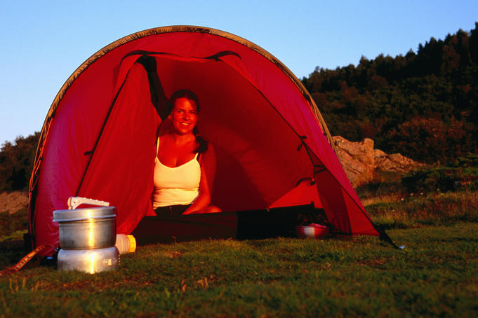 Woman sitting in tent.