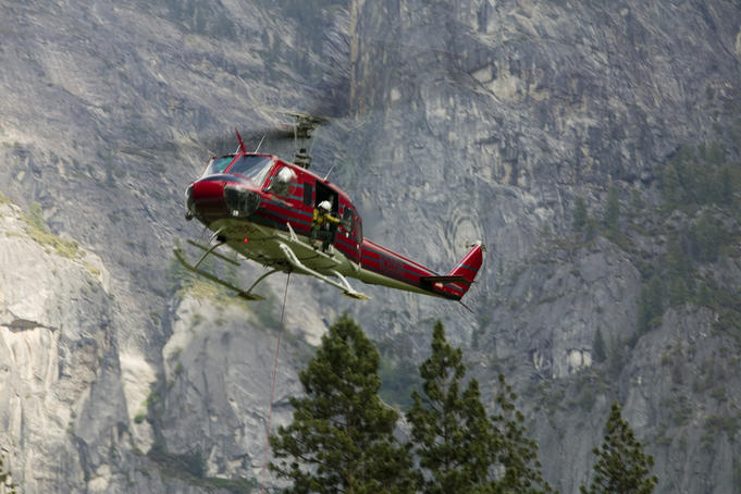 Rescue helicopter in front of one of Yosemite Valley's big walls.