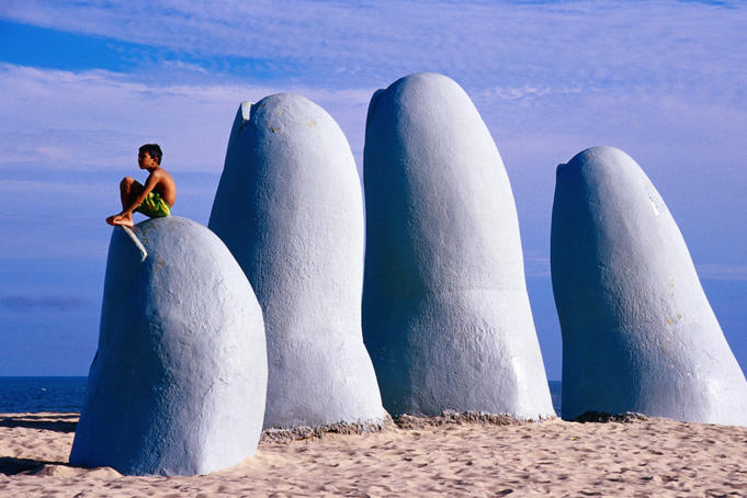 'El Mano' beach sculpture on Playa Brava.