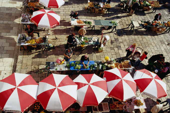 Overhead of umbrellas and stalls at Gunduliceva Poljana Market.