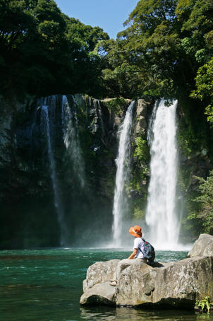 Person looking at waterfall, Cheonjiyeon Gorge.