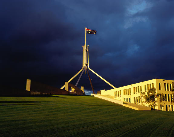 Parliament House with storm clouds in background.