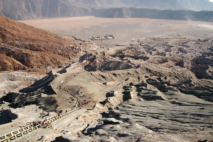 Stairs leading to Gunung Bromo's crater, with carpark, Hindu temple and Sand Sea beyond.