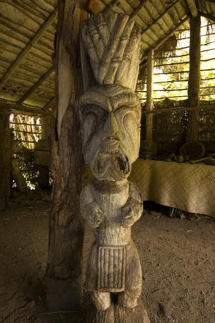 Kamokila Hawaiian Village, carved effigy in house.