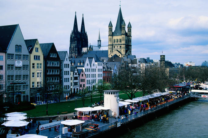 The Altstadt (old town) long the Rhine River with Cologne Cathedral (Kolner Dom), left, and Church of Gross Saint Martin, right, in the background.