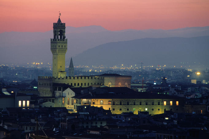 City skyline, with Palazzo Vecchio, illuminated at dusk.