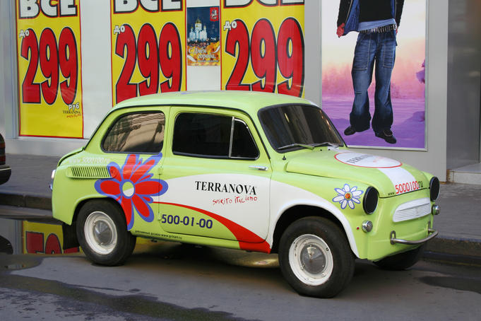 Soviet era motor car advertising a clothing store.