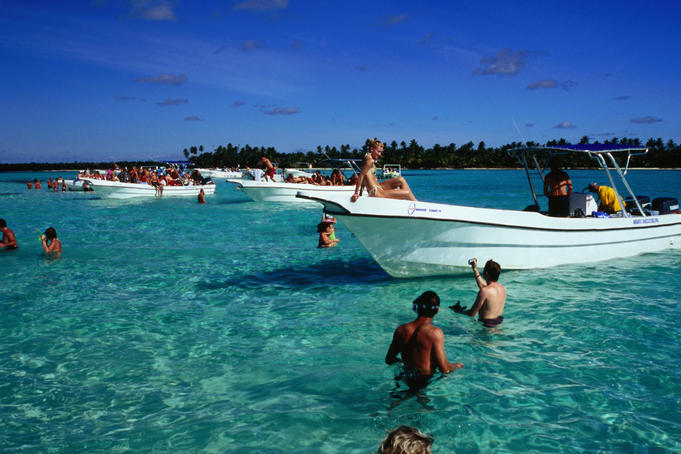 Tourists enjoying sun and sea near Punta Cana.