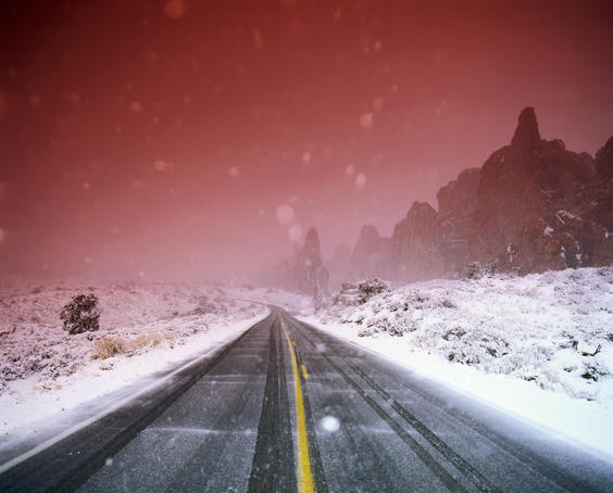 Road with falling snow.