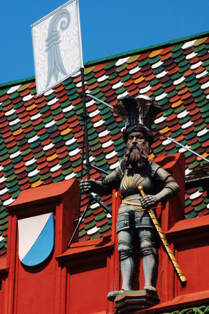 Detail of vivid red Rathaus (town hall) facade, with statue carrying Basel's coat of arms and rival Z