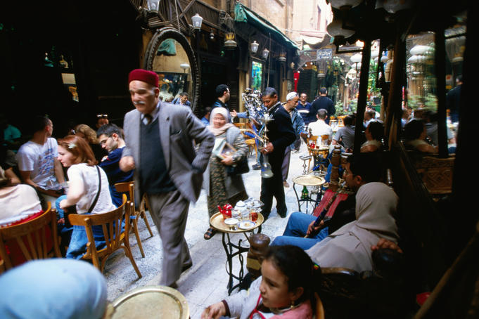 People at Fishawi (coffee house), Bazaar of Khan al-Khalili, market area.