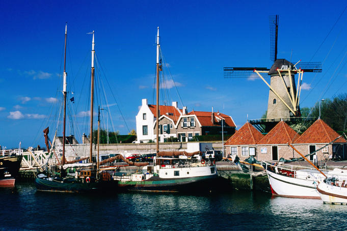 Harbour with windmill in background.