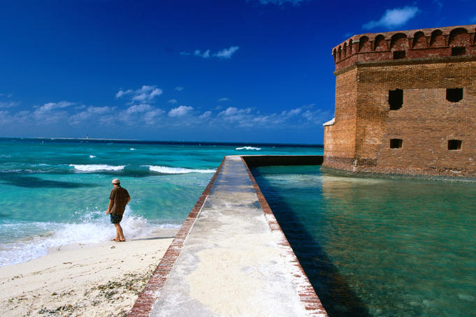 Tourist near moat wall of Fort Jefferson, Garden Key