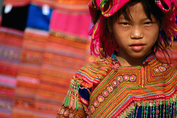 Ethnic Flowery H'mong girl at weekly market in Vietnam's far north, Ban Lo.