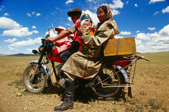Family transport, family on motorbike.