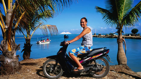 Girl on scooter, Rarotonga & the Cook Islands