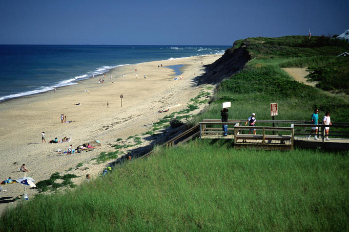 People taking the board walk to the Cape Cod National Seashore, the Atlantic ocean dunes - Cape Cod, Massachusetts